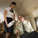 Stewardess-pouring-champagne-for-man